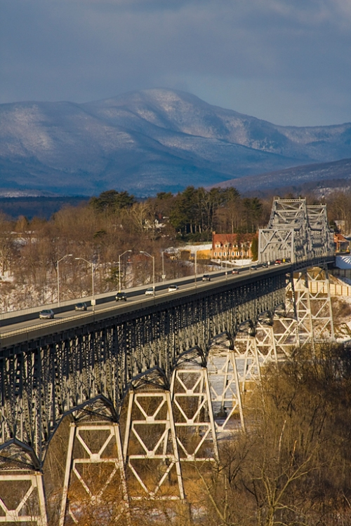 The Rip Van Winkle Bridge spans the Hudson River. The Catskills are in the background.