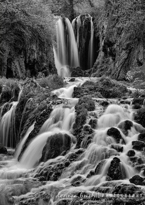 Water falls into a babbling cascade at Roughlock Falls in the Black Hillsof South Dakota.