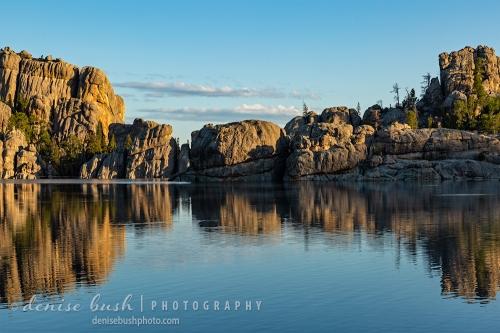 As the sunrises it illuminates more of Sylvan Lake's beautful rock formations.
