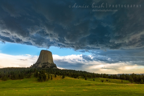An ominous storm cloud appears above Devils Tower to create a dramatic Wyoming scene.