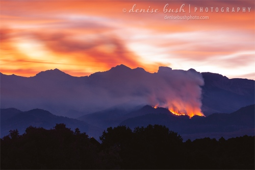 A wildfire burns throughout the night and into the pre-dawn hours in the Cimarrons of the San Juan Mountains near Ridgway, Colorado.