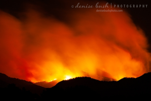 A wildfire in a mountainous national forest takes on an ominous look at night.