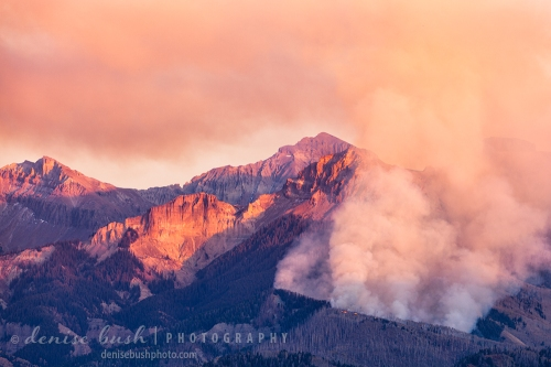 The last light of day illuminates a forest fire in the mountains near Ridgway Colorado.