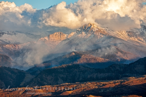 After some welcome snow a wildfire smolders in the Cimarron Mountains near Ridgway Colorado.