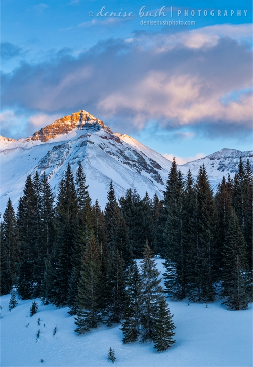 Last light of day strikes an exposed peak in the San Juan Mountains, San Miguel County, Colorado.