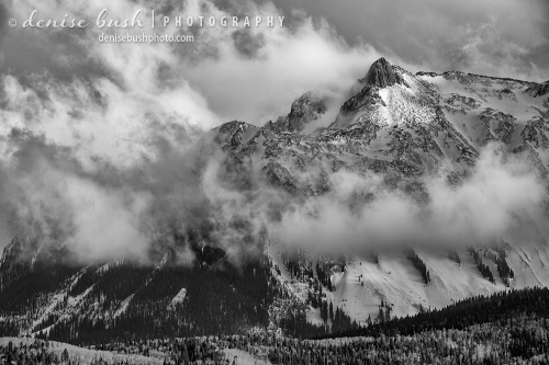 A knobby peak reveals itself as a winter storm clears in the mountains of Ouray County, Colorado.