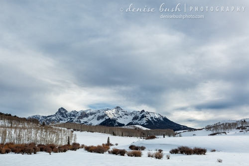 A wintry scene in the San Juan Mountains of Colorado featuring Hayden Peak and North Pole Peak.