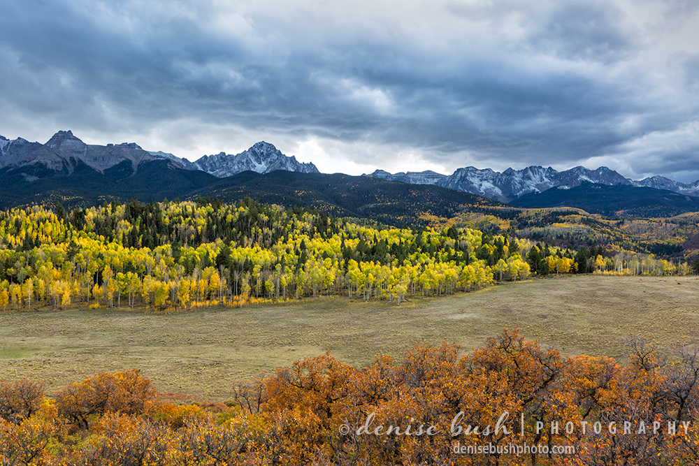 Storm Clouds hover above the Sneffels Range and the vibrant colors of fall.