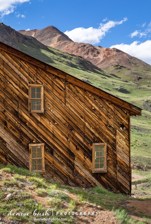 An abandoned stamp mill from the mining days has an interesting diagonal slope and siding following in line with the background mountain.