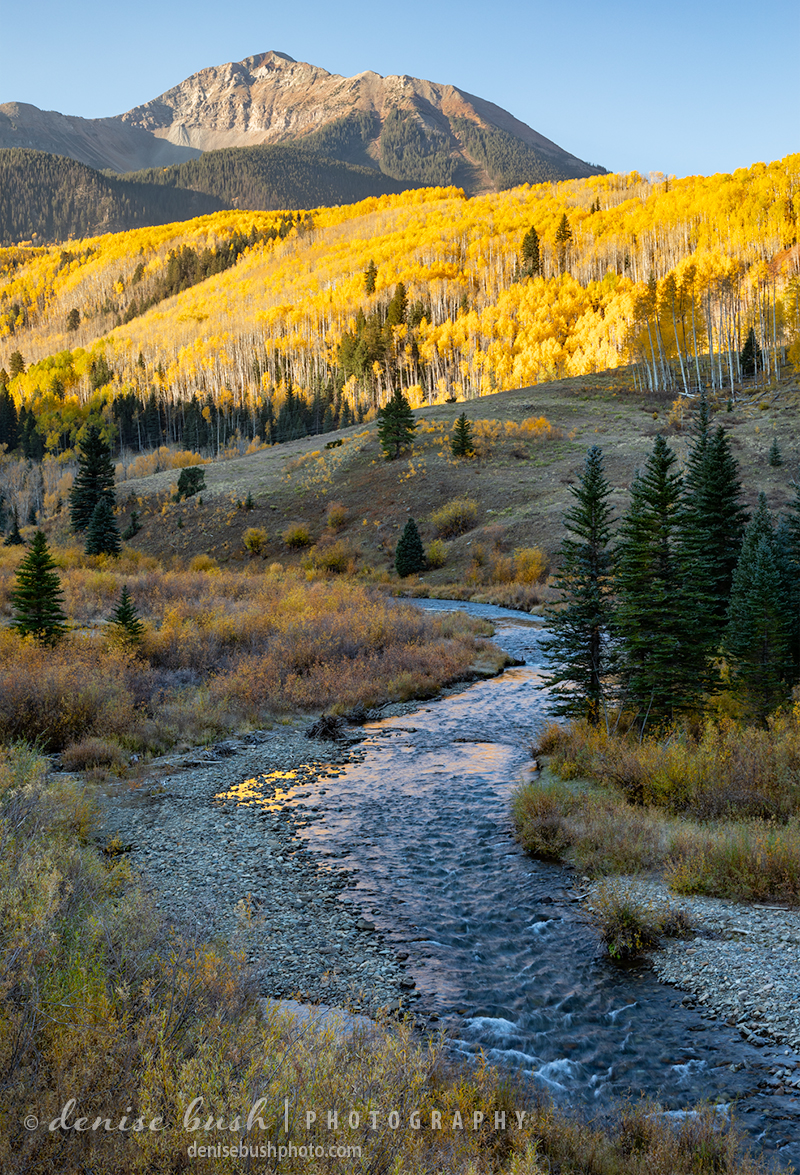 A river flows away from Sunshine Mountain near Telluride, Colorado.