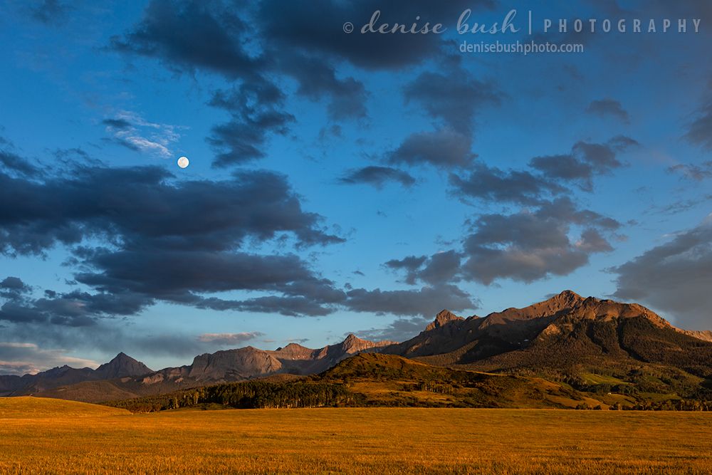 Last light and tthe appearance of the moon create a beautiful mountain scene.