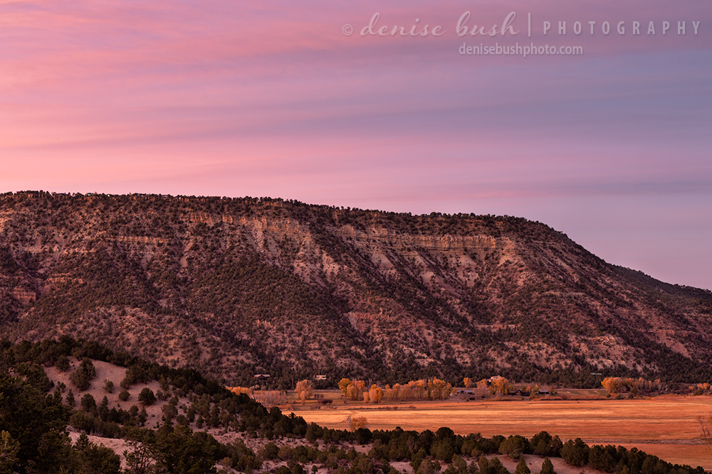 A pretty pink sunset sky settles over Loghill Mesa outside of Ridgway, Colorado.