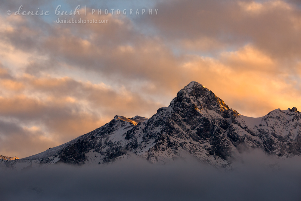 A peak in the Sneffels Range, S9 peeks out of the clouds in time to shine in the setting sun.