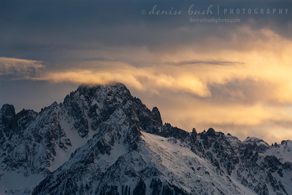 Clouds drift over Sneffels peak in a game of hide n seek.