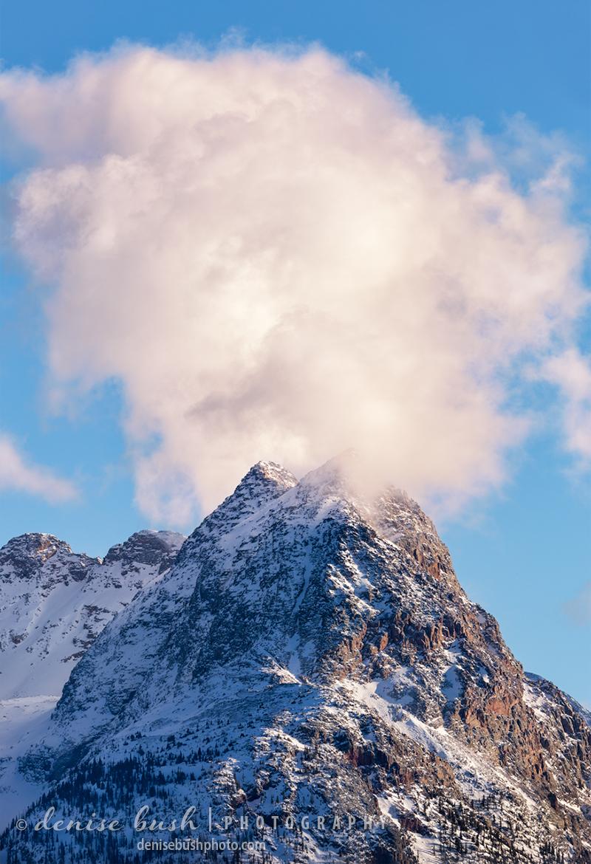 A a hovering cloud makes peak in the Grenadier Range of Southwest Colorado look like it's smoking.