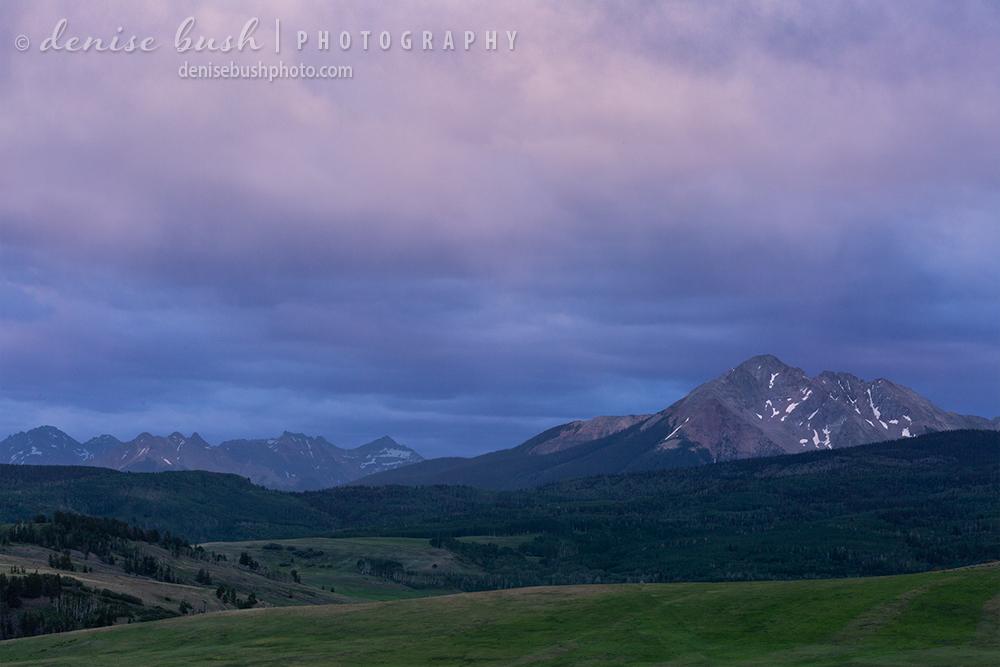 A smoky sky turns pink over Sunshine Mountain, near Telluride, Colorado.