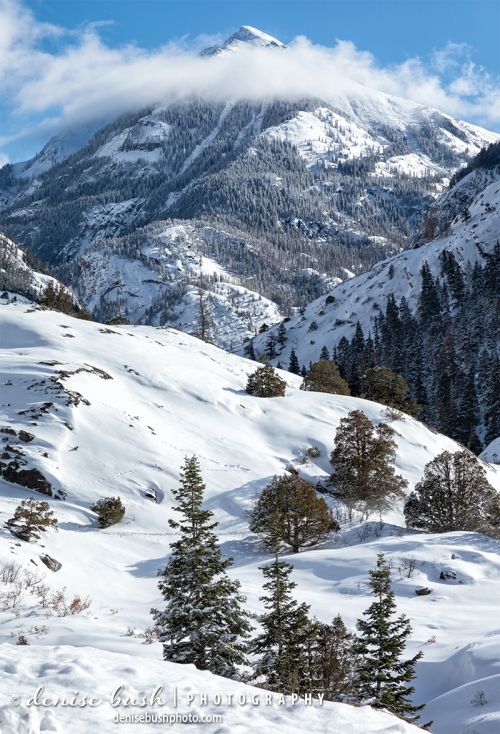 Clouds lift after a winter storm, just below the peak of Mount Abram in Ouray, Colorado.