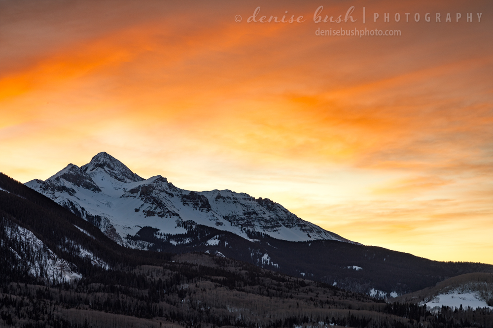 Sunset takes on a fiery look over Mount Wilson near Telluride, Colorado.