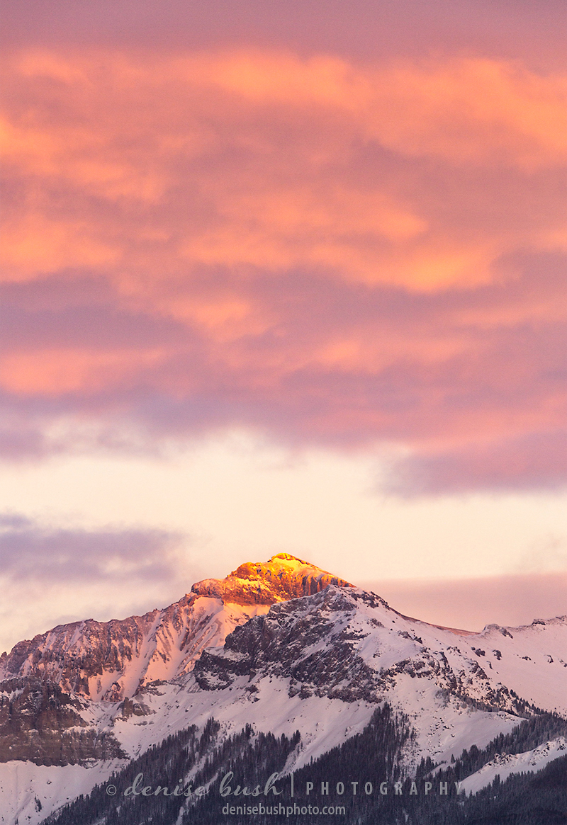 Redcliff Mountain near Ridgway Colorado lights up with the last warm light of the day.