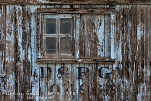 An old rail car with a window creates an image full of texture and nostalgia.