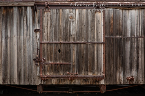 The side of an old rail car creates an image rich in texture and nostalgia.