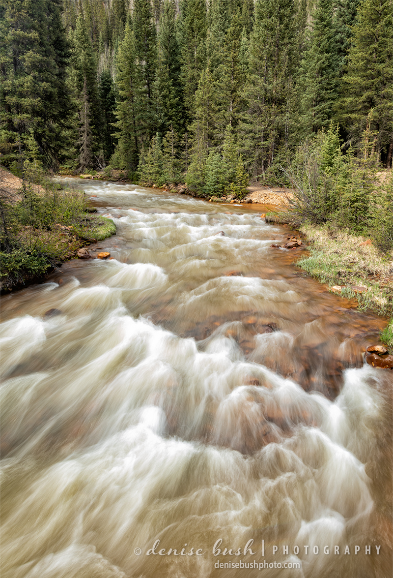 A fast moving stream rushes water from the mountains near Silverton, Colorado to meet up with a river below.