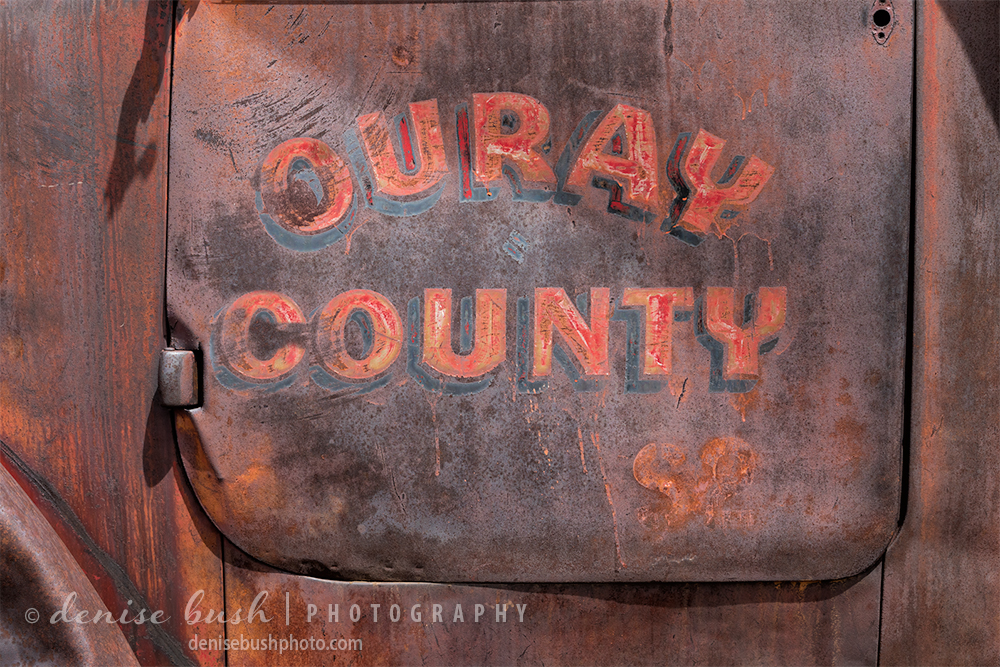 Close-up of an old door on a truck at one time belonging to Ouray County.