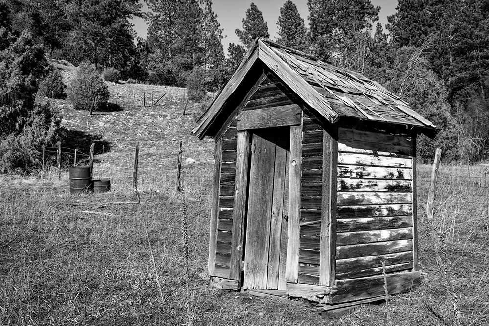 A weathered outhouse is a reminder of less luxurious times.