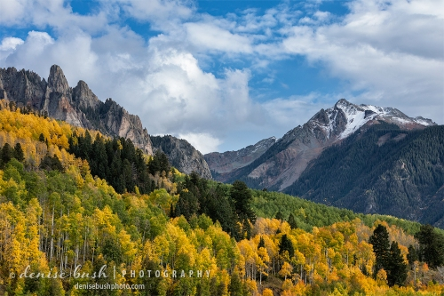 Pretty clouds and light create a tranquil autumn scene, in the San Juan Mountains of Colorado.
