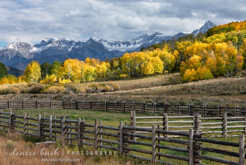 A wooden corral is an accent to a beautiful scene near Ridgway, Colorado.